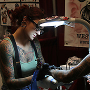 Tattoo artist Soledad Del Real, at the 18th Annual South Florida Tattoo Expo.<br />
