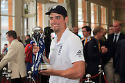 Captain Alastair Cook lifts the Investec Series Trophy after the third and final Investec Test Match between England and Sri Lanka at Lord's. Photo: Graham Morris/ www.photosport.nz