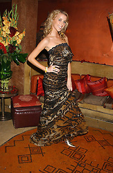AYESHA MAKIM in a long animal-print gown by Gianfranco Ferre at a dinner hosted by Ayesha Makim and leading stylist Mohieb Dahabieh to celebrate the forthcoming London Fashion Week held at the exotic restaurant Levant, 76 Wigmore Street, London W1 on 8th September 2005.<br /><br />NON EXCLUSIVE - WORLD RIGHTS