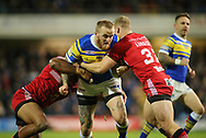 Dom Crosby (C) of Leeds Rhinos tackled by Lama Tasi (L) and Joey Lussick (R) of Salford Red Devils during the Super 8s Qualifiers match at Emerald Headingley Stadium, Leeds<br /> Picture by Stephen Gaunt/Focus Images Ltd +447904 833202<br /> 14/09/2018