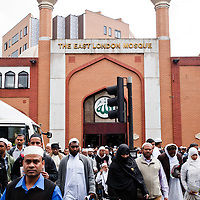 London, UK - 20 July 2012: the Muslim community leaves the East London Mosque right after the Friday prayer celebrating the first day of Ramadan.