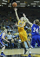 December 20, 2011: Iowa Hawkeyes guard Jaime Printy (24) puts up a shot over Drake Bulldogs guard Amber Wollschlager (34) during the NCAA women's basketball game between the Drake Bulldogs and the Iowa Hawkeyes at Carver-Hawkeye Arena in Iowa City, Iowa on Tuesday, December 20, 2011. Iowa defeated Drake 71-46.