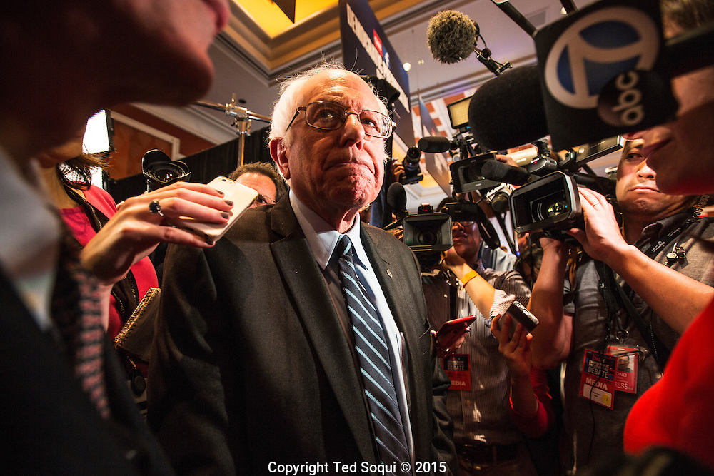Bernie Sanders surrounded by media in the spin room, post debate.<br /> The first Democratic Presidential Debate at the Wynn Hotel in Las Vegas.