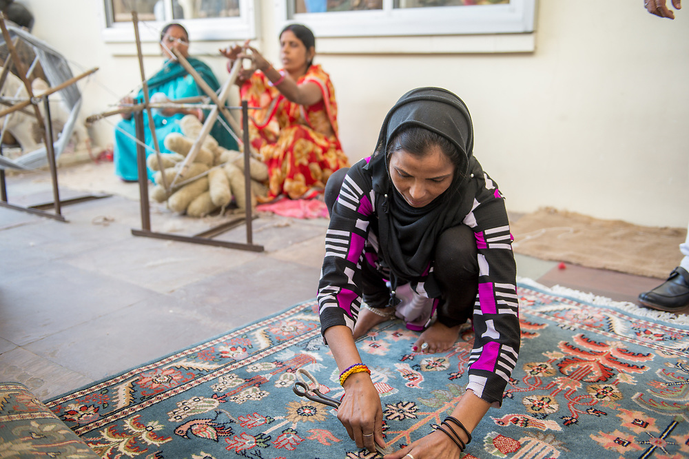 Jaipur, India - Indian women making oriental rugs