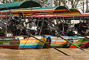 Long propeller shafts of long tail boats in a khlong (canal), Bangkok, Thailand