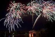 Middletown, New York - Fireworks light the sky over the lake at Fancher-Davidge Park in a display that was part of the celebration of the 125th anniversary of the founding of the City of Middletown on June 29, 2013.