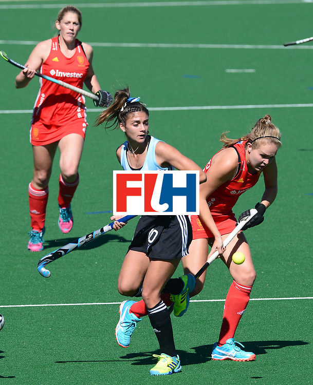 JOHANNESBURG, SOUTH AFRICA - JULY 23: Emily Defroand of England gets past Magdalena Fernandez of Argentina during day 9 of the FIH Hockey World League Women's Semi Finals 3rd-4th place match between England and Argentina at Wits University on July 23, 2017 in Johannesburg, South Africa. (Photo by Getty Images/Getty Images)