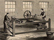 The slubbing-billy, inventor uncertain, which came into use in about 1786.  Used to spin carded wool into rovings.    From 'Great Industries of Great Britain' (London, c1880).  Engraving.