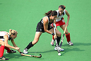 Kayla Sharland battles with Phillippa Jones during the pool B women's hockey match of the The Commonwealth Games between New Zealand and Wales held at the Stadium in New Delhi, India on the  October 2010..Photo by:  Ron Gaunt/SPORTZPICS/PHOTOSPORT