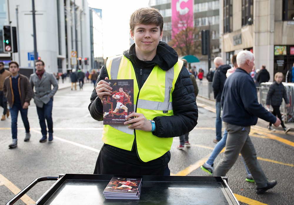 A programme seller outside the stadium<br /> <br /> Photographer Simon King/Replay Images<br /> <br /> Under Armour Series - Wales v Australia - Saturday 10th November 2018 - Principality Stadium - Cardiff<br /> <br /> World Copyright © Replay Images . All rights reserved. info@replayimages.co.uk - http://replayimages.co.uk