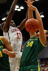 February 26, 2011; Stanford, CA, USA;  Stanford Cardinal forward Chiney Ogwumike (13) and Oregon Ducks forward/center Nicole Canepa (54) reach for a loose ball during the first half at Maples Pavilion.  Stanford defeated Oregon 99-60.
