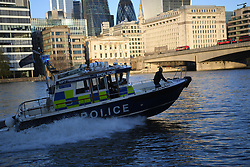 © Licensed to London News Pictures. 29/11/2019. London, UK.  Police on the River Thames at London Bridge. Emergency response agencies react to a major incident on London Bridge, evacuating nearby Borough Market and office blocks as shots are fired near a bus..  Photo credit: Guilhem Baker/LNP