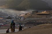 Pilgrims walk kora which surrounds the town of Langmusi.