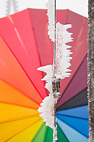 Mt. Rigi, Central Switzerland. Ice crystals formed on a metal rod, positioned in front of a colorful rainbow umbrella.