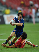 Canada's Nathan Hirayama tackles USA's Ben Pinkelman during the HSBC World Rugby Sevens Series - Singapore match USA-V-Canada - Cup Final at The National Stadium, , , Singapore on Sunday, April 16, 2017. (Steve Flynn/Image of Sport)