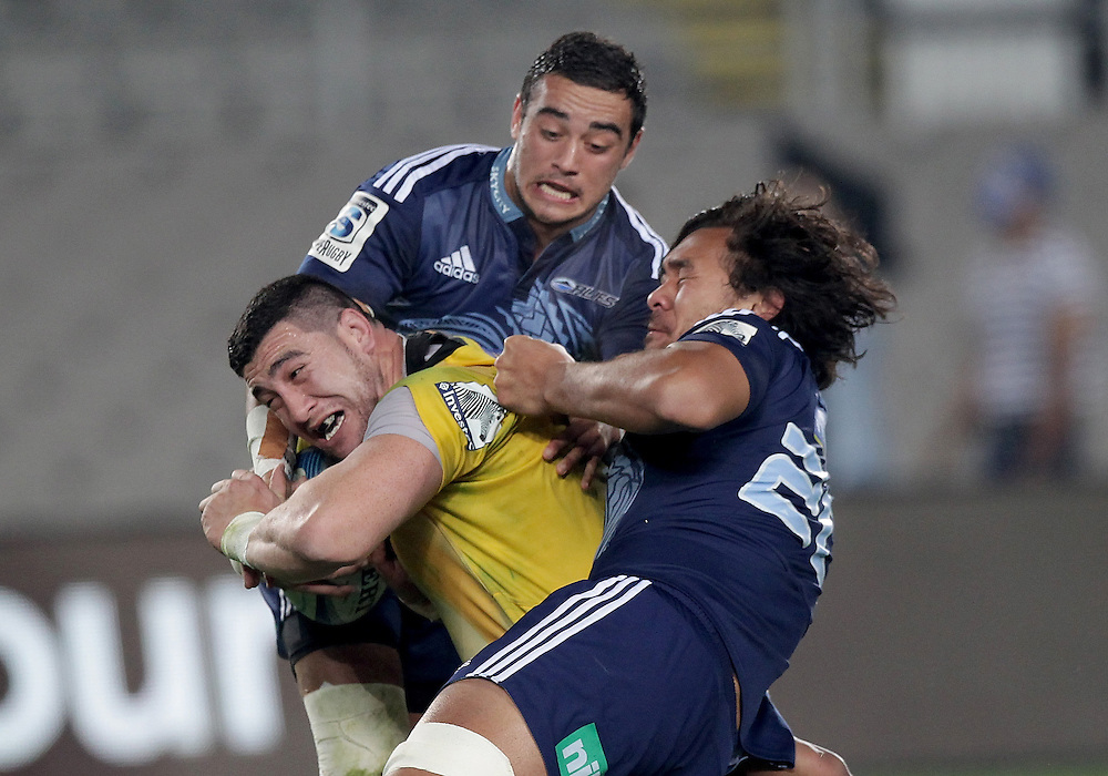 Hurricanes' Jeffery Toomaga-Allen is tackled by Blues' Bryn Hall and Steven Luatua in a Super Rugby match, Eden Park, Auckland, New Zealand, Saturday, May 31, 2014.  Credit:SNPA / David Rowland