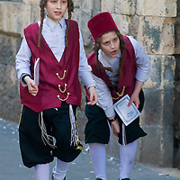 JERUSALEM - MARS 09 : Ultra Orthodox costumed boys during Purim in Mea Shearim Jerusalem on Mars 09 2012 , Purim is a Jewish holiday celebrates the salvation of the jews from jenocide in ancient Persia.