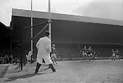 23/05/1965<br /> 05/23/1965<br /> 23 May 1965<br /> National Hurling League Final: Tipperary v Kilkenny at Croke Park, Dublin.<br /> The turning point of the game as Tipperary's first goal sails past Kilkenny's goalie, Q. Walsh.