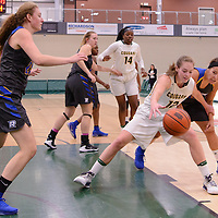 3rd year forward Christina McCusker (12) of the Regina Cougars in action during the Women's Basketball Preseason game on October 6 at Centre for Kinesiology, Health and Sport. Credit: Arthur Ward/Arthur Images