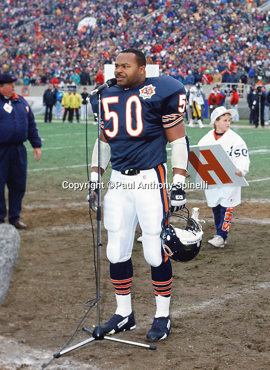 Chicago Bears linebacker Mike Singletary (50) is honored with a tribute to his playing career at halftime of his last home game during the NFL football game against the Pittsburgh Steelers on Dec. 13, 1992 in Chicago. The Bears won the game 30-6. (©Paul Anthony Spinelli)