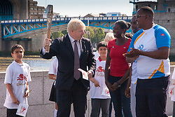 London, June 6th 2014. Mayor of London Boris Johnson joins Olympic and Commonwealth champion Christine Ohuruogu MBE to welcome the Commonwealth Games Queen's Baton Relay to the Capital.
