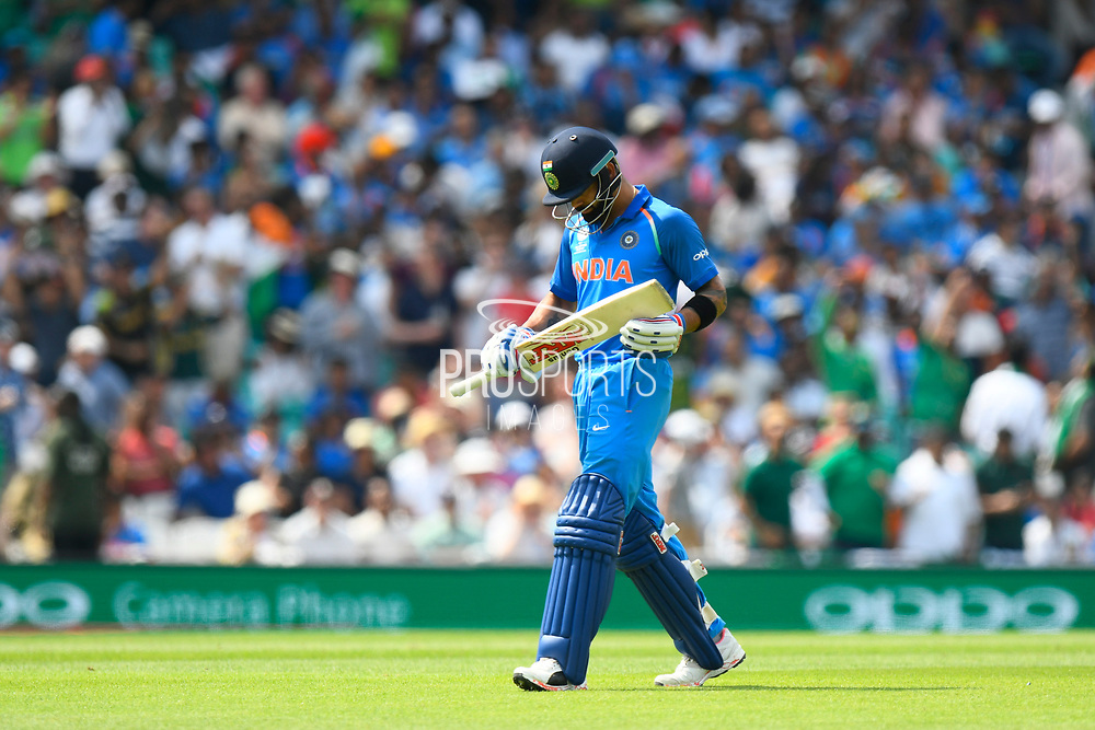 Wicket - Virat Kohli (captain) of India walks back to the pavilion after being dismissed by Mohammad Amir of Pakistan during the ICC Champions Trophy final match between Pakistan and India at the Oval, London, United Kingdom on 18 June 2017. Photo by Graham Hunt.
