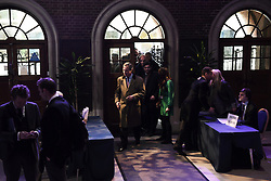 "© London News Pictures. ""Looking for Nigel"". A body of work by photographer Mary Turner, studying UKIP leader Nigel Farage and his followers throughout the 2015 election campaign. PICTURE SHOWS - Nigel Farage arrives at the Emmanuel Centre in Westminster, London ahead of his major campaign speech on immigration on March 3rd 2015. Pictured to his right are (l-r)  Nigel's strategist Raheem Kassam, his personal assistant Lizzy Vaid, Immigration spokesperson Stephen Woolfe, Press officer Alex Phillips, and (seated) is junior press oficer John Gill. . Photo credit: Mary Turner/LNP **PLEASE CALL TO ARRANGE FEE** **More images available on request**"