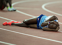 Athletics - 2017 IAAF London World Athletics Championships - Day Nine, Evening Session<br /> <br /> Mens 5000m Final<br /> <br /> Mo Farah (Great Britain) collapses in despair after he his beaten at the London Stadium<br /> <br /> COLORSPORT/DANIEL BEARHAM