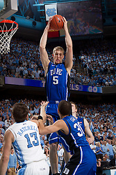 CHAPEL HILL, NC - MARCH 05: Mason Plumlee #5 of the Duke Blue Devils rebounds while playing the North Carolina Tar Heels on March 05, 2011 at the Dean E. Smith Center in Chapel Hill, North Carolina. North Carolina won 67-81. (Photo by Peyton Williams/UNC/Getty Images) *** Local Caption *** Mason Plumlee