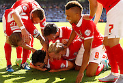 Tony Watt is joined by his teammates to celebrate his second had opener during the Sky Bet Championship match between Charlton Athletic and Queens Park Rangers at The Valley, London, England on 8 August 2015. Photo by Andy Walter.