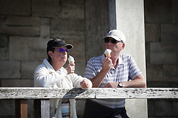 © Licensed to London News Pictures. 02/10/2015. Southsea, Hampshire, UK. A couple enjoying an ice cream in the sunny weather in Old Portsmouth, Hampshire today, 2nd October 2015. The weekend weather is set to be dry and fine day in the south of England. Photo credit : Rob Arnold/LNP