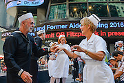 """Dancers dressed as the sailor and nurse in Eisenstaedt's photograph perform a period dance piece before the start of the event. To mark the 70th anniversary of the surrender of the Japanese ending WWII, the Times Square Alliance and """"Spirit of '45,"""" a WWII legacy organization, hosted a kiss-in with members of the public invited to imitate the sailor and nurse in Alfred Eisenstaedt's famous photograph. (PHOTO: Abin Lohr-Jones/BRAZIL PHOTO PRESS)"""