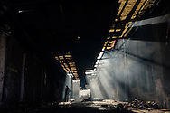 In derelict warehouses behind Belgrade's main bus station, up to 1500 migrants are trying to survive the freezing Serbian winter in a crumbling building with broken windows, no electricity, no heating, or water. They are surviving without sanitation and in a sub-zero winter.
