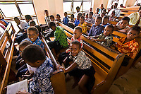 Fijian boys attending a Methodist church service in their village on Vatulele Island, Fiji Islands
