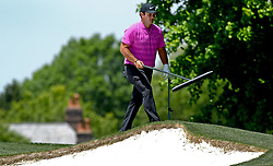 May 3, 2018 - Charlotte, NC, USA - Patrick Reed walks with the sand rake along the 3rd fairway during he first round of the Wells Fargo Championship at Quail Hollow Club in Charlotte, N.C., on Thursday, May 3, 2018. (Credit Image: © Jeff Siner/TNS via ZUMA Wire)