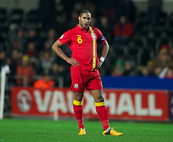 SWANSEA, WALES - Tuesday, March 26, 2013: Wales' captain Ashley Williams looks dejected as Croatia score the equalising goal during the 2014 FIFA World Cup Brazil Qualifying Group A match at the Liberty Stadium. (Pic by David Rawcliffe/Propaganda)