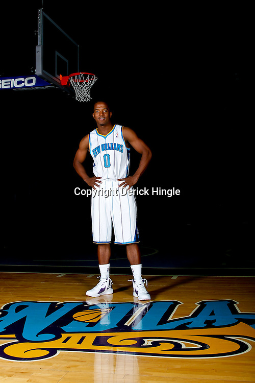 December 14, 2011; New Orleans, LA, USA; New Orleans Hornets guard Carldell Johnson (0) poses for a photo during Media Day at the New Orleans Arena.   Mandatory Credit: Derick E. Hingle-US PRESSWIRE