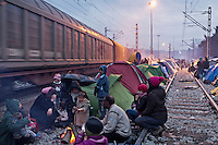 Greece, Idomeni, Refugee Children,<br /> Many families put up their tents close to the railroad track, because of the heavy rainy days, the railroad track is much better as the places on the fields around the train station. Those became to muddy to stay. Even the cargo trains, didn&acute;t affect the families to stay close to the rails. Passenger trains are not passing these days through Idomeni.<br />  <br /> Refugees from Syria, Irak, Afghanistan and others from the near east are trying to reach the border between Greece and Macedonia (FYROM). <br /> Idomeni, is the eye of a needle for getting to northern Europe. <br /> The FYROM authorities, closed the border to Greece completely. The situation gets more and more difficult. The refugees have to sleep outside or in small tents. <br /> Heavy rainfalls and cold nights are treating the refugees badly. There is not enough food and supplies to help about 14.000 refugees. March 2016<br /> <br /> keine Veroeffentlichung unter 50 Euro*** Bitte auf moegliche weitere Vermerke achten***Maximale Online-Nutzungsdauer: 12 Monate !!