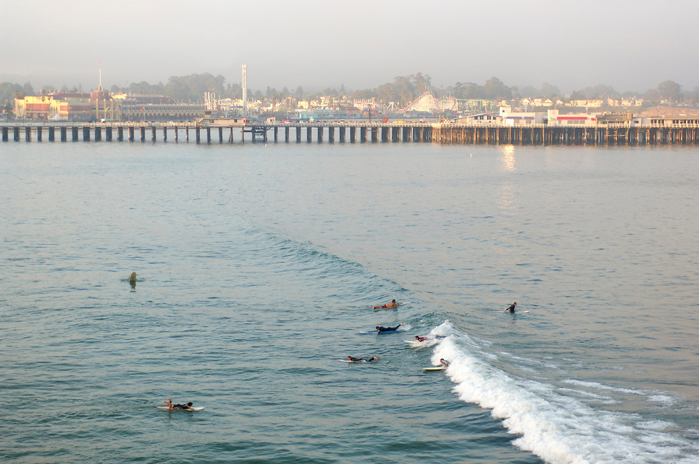 Surfer in front of Santa Cruz Pier, Santa Cruz, California, United States of America