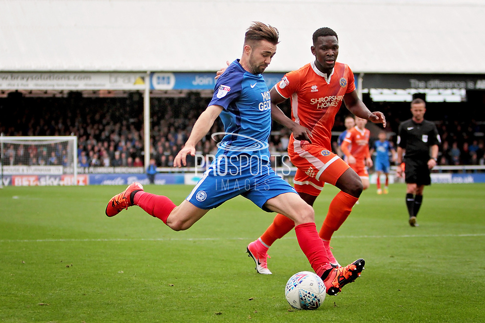 Peterborough United midfielder Gwion Edwards (7) gets in a shot during the EFL Sky Bet League 1 match between Peterborough United and Shrewsbury Town at London Road, Peterborough, England on 28 October 2017. Photo by Nigel Cole.