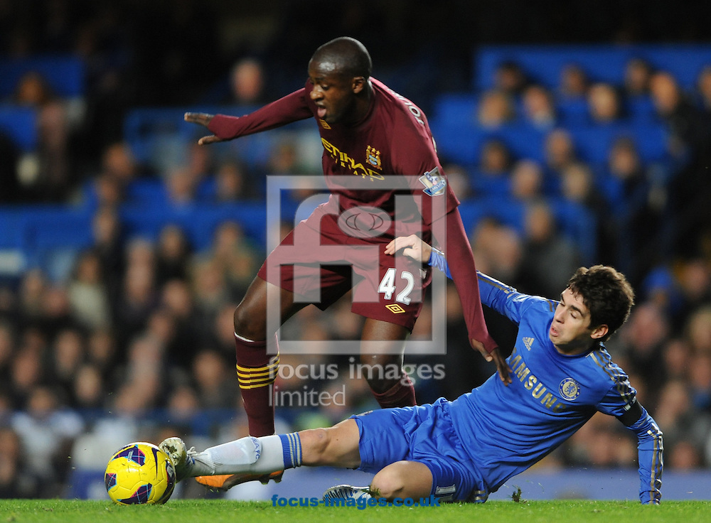 Picture by Daniel Hambury/Focus Images Ltd +44 7813 022858.25/11/2012.Oscar of Chelsea and Yaya Toure of Manchester City during the Barclays Premier League match at Stamford Bridge, London.