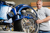 Mid-adult mechanic repairing motorcycle