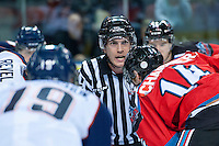KELOWNA, CANADA - AUGUST 30:  Kevin Crowell, linesman stands at centre ice to drop the puck between the Kelowna Rockets and the Kamloops Blazers on August 30, 2014 during pre-season at Prospera Place in Kelowna, British Columbia, Canada.   (Photo by Marissa Baecker/Shoot the Breeze)  *** Local Caption *** Kevin Crowell;