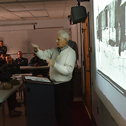BATH, Maine -- 9/19/14 -- WWII Veteran and former POW, Stewart Day of Bath, Maine speaks to members of the Zumwalt Precommissioning Unit  on POW/MIA Day, Sept 19.  Day, 91, flew 19 missions as a Tail Gunner in a B-17 over Europe before being shot down and captured. He spent the last days of WWII in a Prisoner of War camp, known as Stalag 17B. He presented his memories to the U.S. Navy unit based in his home town of Bath. U.S. Navy Photo by Chief Mass Communication Specialist Roger S. Duncan (RELEASED)