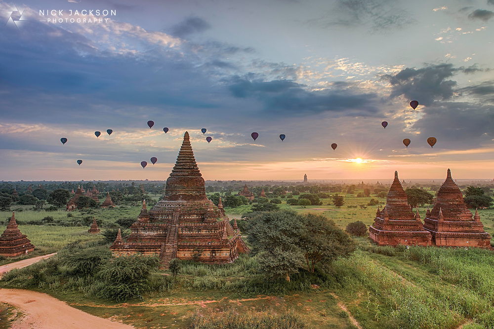 Ballooning over the temples of Bagan, Myanmar, at sunrise is an incredible experience. Second to that, sitting on the top of a temple and watching them float by is pretty magical too.