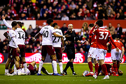 Referee Mike Dean tries to calm the players from Nottingham Forest and Aston Villa - Mandatory by-line: Robbie Stephenson/JMP - 13/03/2019 - FOOTBALL - The City Ground - Nottingham, England - Nottingham Forest v Aston Villa - Sky Bet Championship