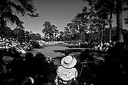 Patrons watch the action on No. 7 during the Par 3 Contest at Augusta National Golf Club, Wednesday, April 6, 2011.