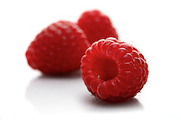 Raspberries on white background - close-up
