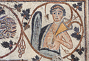 Detail of a Byzantine floor mosaic depicting a figure representing the seasonal harvest with a horn of plenty and vine leaves, 587 AD, from the Church of Bishop Sergius, built 586 AD in the time of Bishop Sergius of Madaba, Umm ar-Rasas, Amman, Jordan. This is the only human figure to remain in the mosaic cycle as it was protected by the stone base of a later pulpit, the others having been destroyed by Christian iconoclasts. The church was built as a basilica with an apse and elevated presbytery and forms part of an ecclesiastical complex of 4 churches. Umm ar-Rasas is a rectangular walled city which grew from a Roman military camp in the Jordanian desert. Its remains date from the Roman, Byzantine and Umayyad periods (3rd - 9th centuries), including 16 churches with mosaic floors. Excavations began in 1986, although most of the site remains unexplored. It was declared a UNESCO World Heritage Site in 2004. Picture by Manuel Cohen