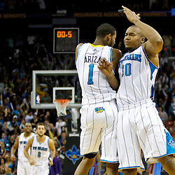 January 24,  2011; New Orleans, LA, USA; New Orleans Hornets power forward David West (30) celebrates with small forward Trevor Ariza (1) after hitting the game winning shot against the Oklahoma City Thunder during the final seconds of the fourth quarter at the New Orleans Arena. The Hornets defeated the Thunder 91-89. Mandatory Credit: Derick E. Hingle